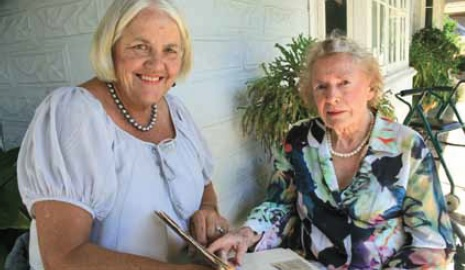 Anne Ward and Berna Wright with press cuttings of family history