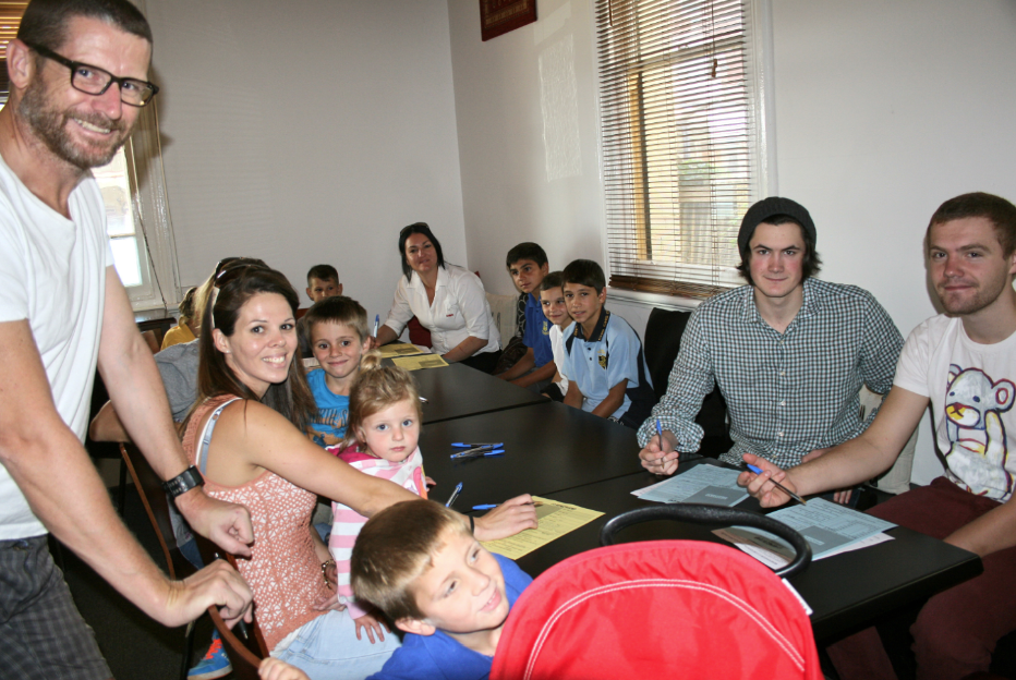 Casting director Gordon Smallbone signs up the kids at Canowindra's Royal Hotel.