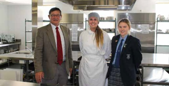 John Cobb with Red Bend student Danica Bartholomaeus and Head Prefect Illie Hewitt in the new hospital facility