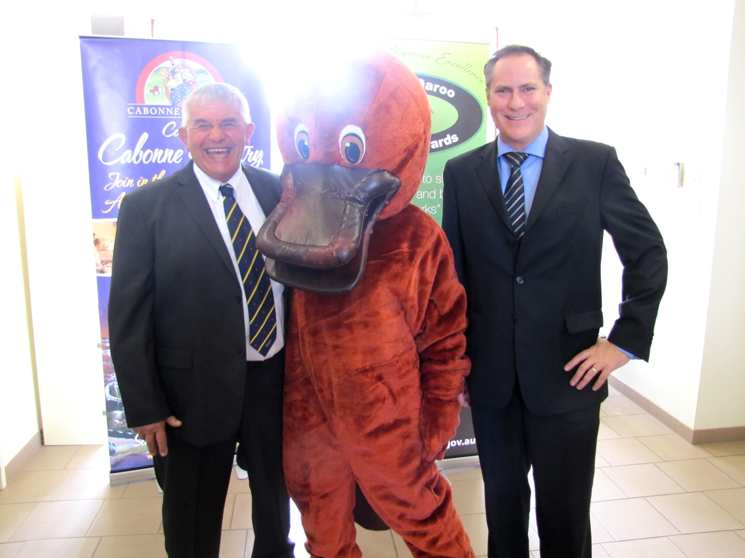 """Cabonne Mayor Ian Gosper (left) and General Manager Andrew Hopkins with """"Daroo the Platypus""""  the mascot for the Cabonne Business Awards which were launched today."""