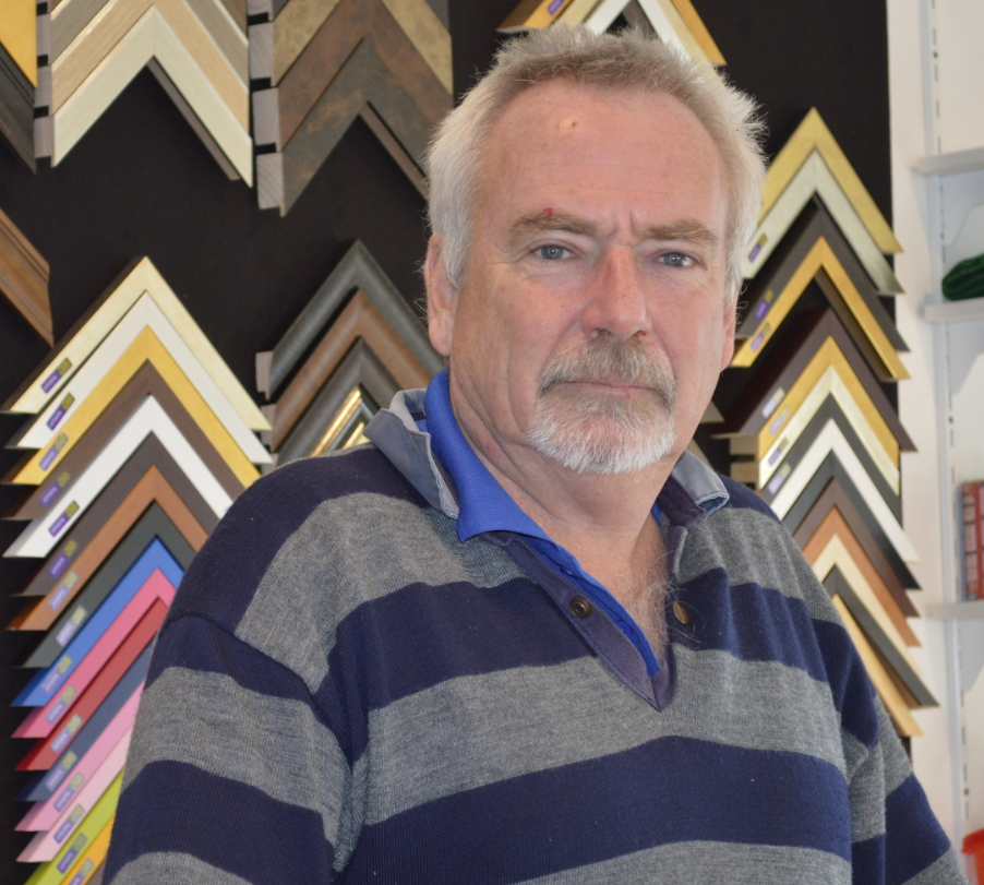 Craig Peters with a range of his picture frames in the background