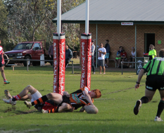 Curtis Hughes scoring a try for youth league
