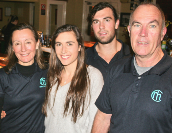 A family affair – John Watson, his son Jarrod, daughter Rebecca and wife Stephanie tended the bar at Saturday's birthday evening.