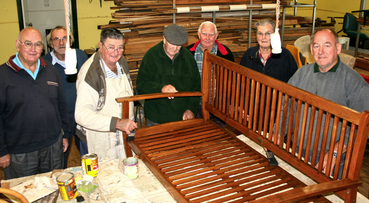 Warrick Bowd (far right) with men's shed comrades and latest restoration job