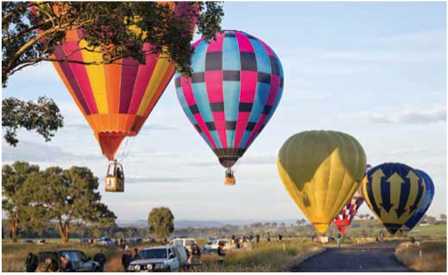 Balloons completing competition task during the 2014 Canowindra Balloon Challenge