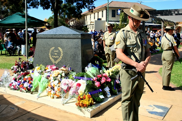Canowindra cenotaph packed with wreaths at this years Anzac Day observance