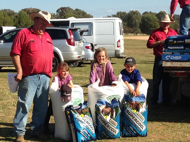 Little arena sorters posing President Michael Newcombe and their prizes