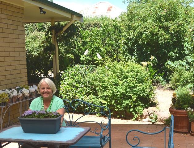 Anne relaxing in the garden