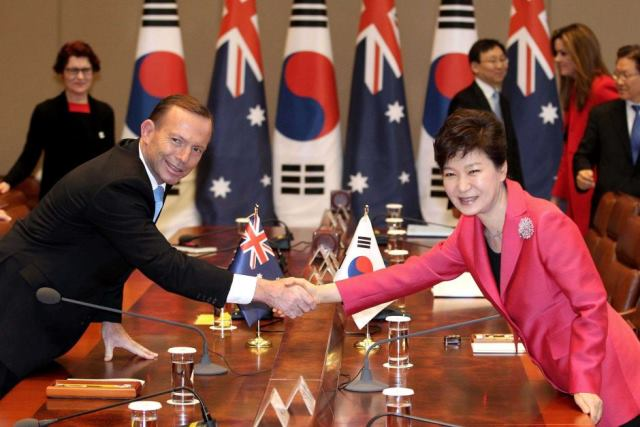 Prime Minister Tony Abbott shakes hands with South Korea's president Park Geun-hye. photo Ahn Young-joon