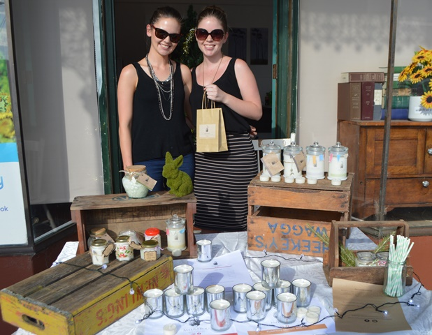 jess jenkins and sister dani sold candles at the canowindra shopping night